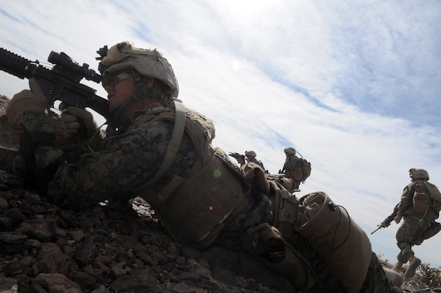 Marines of Company C, 1st Battalion, 2nd Marine Regiment, open fire on targets during a company-sized exercise at the U.S. Army Yuma Proving Ground in Arizona, Oct. 27, 2009. The Camp Lejeune, N.C.-based battalion spent approximately one month the Yuma area, making use of its surroundings' rocky, mountainous terrain in preparation for a deployment to Afghanistan early next year. The exercise stressed the approximately 220-Marine force to use combined arms tactics, ranging from rifles and machine guns to mortars and TOW missiles.