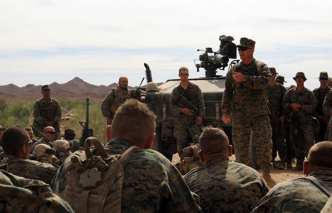 Chief Warrant Officer 2 Kenneth Kurre, 1st Battalion, 2nd Marine Regiment, battalion gunner, talks to Company C Marines following a company-sized exercise at the U.S. Army Yuma Proving Ground in Arizona, Oct. 27, 2009. The Camp Lejeune, N.C.-based battalion spent approximately one month the Yuma area, making use of its surroundings' rocky, mountainous terrain in preparation for a deployment to Afghanistan early next year. The exercise stressed the approximately 220-Marine force to use combined arms tactics, ranging from rifles and machine guns to mortars and TOW missiles.