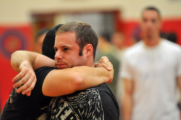 Nick Palmisciano, Ranger Up president, puts Army National Guard Staff Sgt. Tom Amenta in a choke hold during the Train the Troops seminar in the gym at the Marine Corps Air Station in Yuma, Ariz., Oct. 28, 2009. Train the Troops, sponsored and organized by Ranger Up, a mixed martial arts clothing company, visited the station to teach Marines mixed martial arts.
