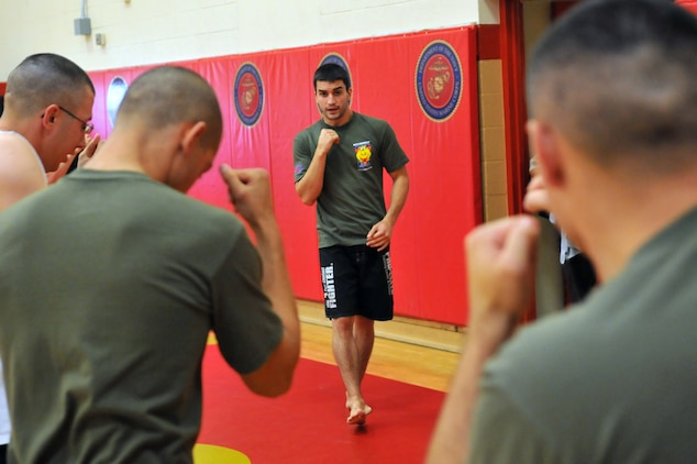 Matt Phinney, a boxing coach with Train the Troops, teaches Marines striking techniques during a half-day seminar at the Marine Corps Air Station in Yuma, Ariz., Oct. 28, 2009. Train the Troops, sponsored and organized by Ranger Up a mixed martial arts clothing company visited the station to teach Marines mixed martial arts.