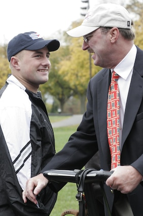 Jerry Kerr, Segs4Vets president, greets Cpl. Jacob Janes after a presentation ceremony at the Marine Corps War Memorial Oct 29. Segs4Vets is an all-volunteer program that provides injured service members with Segways to assist them with their recovery and everyday life. The program is the first and only organization to receive a waiver from the U.S. military allowing a gift in excess of $1,000 to active duty service members.