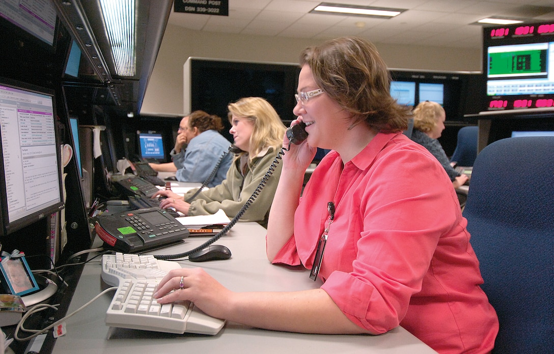 DISA systems administrator Gail Ford and other computer professionals help customers with computer problems around the world. (Air Force photo by Margo Wright)