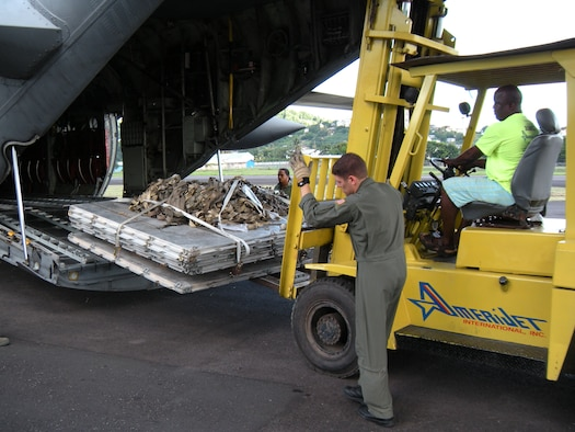 Staff Sgt. James Jorgensen, 731st Airlift Squadron loadmaster, helps to guide a forklift into position to re-load pallets on to a 302nd Airlift Wing C-130 Hercules Oct. 30 after delivering humanitarian supplies to the Caribbean island of St. Vincent. The supplies, donated by Wausau, Wis.-based Good News Project, included hospital and mental health supplies as well as desks, paper and school supplies to various locations on the island. The Air Force Reserve aircraft hauled the supplies under the Denton Amendment, which authorizes U.S. military aircraft via Congress to airlift humanitarian supplies based on space availability and other factors. (U.S. Air Force photo/Staff Sgt. Stephen J. Collier)