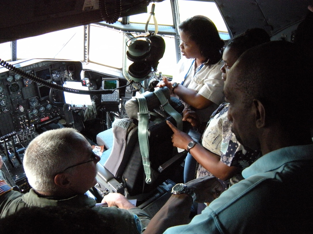 Master Sgt. Ray Wiebe, a C-130 Hercules flight engineer, gives a tour off the aircraft to local officials Oct. 30 after the delivery of humanitarian supplies to the Caribbean island of St. Vincent. The supplies, donated by Wausau, Wis. based Good News Project, included hospital and mental health supplies as well as desks, paper and school supplies to various locations on the island. The Air Force Reserve aircraft transported the supplies under the Denton Amendment, which authorizes U.S. military aircraft via Congress to airlift humanitarian supplies based on space availability and other factors. The C-130 is assigned to the Air Force Reserve Command's 302nd Airlift Wing based at Peterson Air Force Base, Colo. (U.S. Air Force photo/Staff Sgt. Stephen J. Collier)