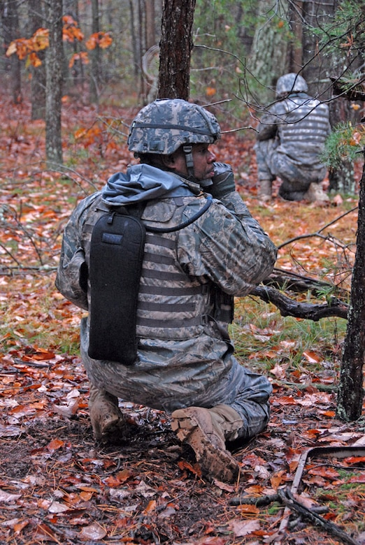 Air Force Master Sgt. Charles Battle, 113th Security Forces Squadron Squad Leader, calls out orders under simulated fire during unmounted patrol training on October 27, 2009. The 113SFS is engaged in pre-deployment training exercises conducted by the U.S. Air Force Expeditionary Center's 421st Combat Training Squadron at Joint Base McGuire-Dix-Lakehurst, N.J. (U.S. Air Force photo/Tech. Sgt. Adrianne L. Wilson)