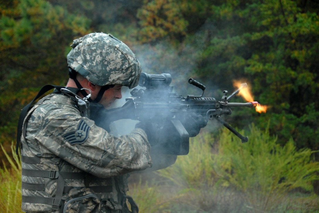 Air Force Staff Sgt. Mark Mondy, 113th Security Forces Squadron Fire Team member, fires his M249 light machine gun during unmounted patrol training on October 27, 2009. The 113SFS is engaged in pre-deployment training exercises conducted by the U.S. Air Force Expeditionary Center's 421st Combat Training Squadron at Joint Base McGuire-Dix-Lakehurst, N.J. (U.S. Air Force photo/Tech. Sgt. Adrianne L. Wilson)
