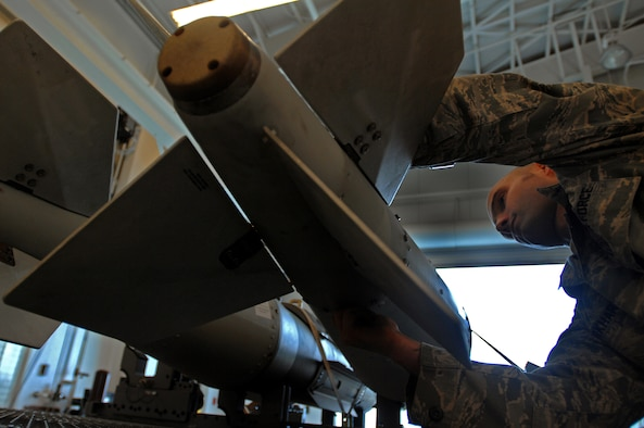 WHITEMAN AIR FORCE BASE, Mo., - Staff Sgt. John Burkhart, 131st Maintenance Squadron conventional maintenance crew chief, ensures the fin bolts are tightened on a GBU 31 weapon, during a post assembly inspection, Oct. 23. Sergeant Burkhart and other members of the 131st MXS build and maintain 11 different types of guided weapons. (U.S. Air Force photo/Senior Airman Kenny Holston)(Released)
