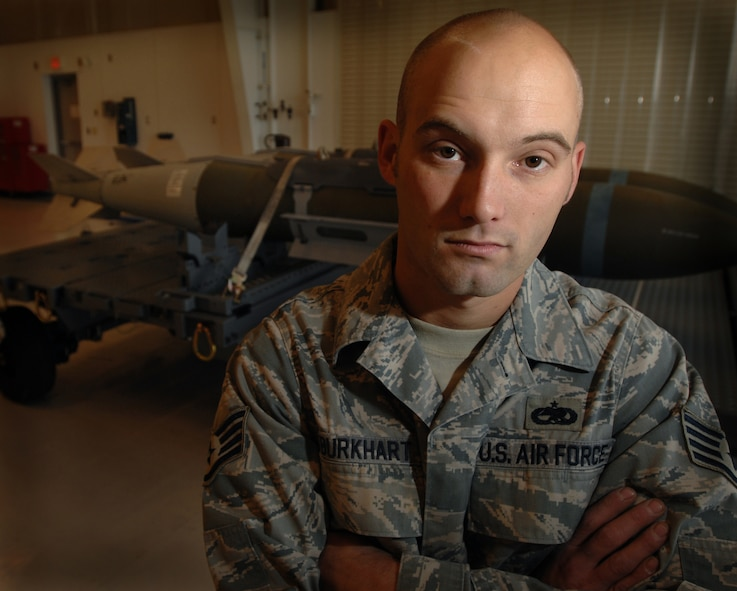 WHITEMAN AIR FORCE BASE, Mo., - Staff Sgt. John Burkhart, 131st Maintenance Squadron conventional maintenance crew chief, poses for a portrait in the 131st munitions maintenance bay, Oct. 23. Sergeant Burkhart is the lead conventional maintenance crew chief for the 131st, teaching munitions maintenance to more than 100 personnel per quarter. Sergeant Burkhart and other members of the 131st MXS build and maintain 11 different types of guided weapons. (U.S. Air Force photo/Senior Airman Kenny Holston)(Released)
