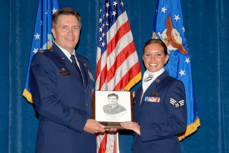 McGHEE TYSON AIR NATIONAL GUARD BASE, Tenn. -- Senior Airman Jennifer M. Kuklenski, an intelligence analyst with the 148th Fighter Wing, Minnesota Air National Guard, receives the John L. Levitow award from Col. Richard B. Howard, commander, for her accomplishments at Airman Leadership School Class 09-6 at The I.G. Brown Air National Guard Training and Education Center here, Oct. 29, 2009.  The John L. Levitow Award is the highest honor awarded a graduate of any Air Force enlisted professional military education course.  (U.S. Air Force photo by Master Sgt. Kurt Skoglund)