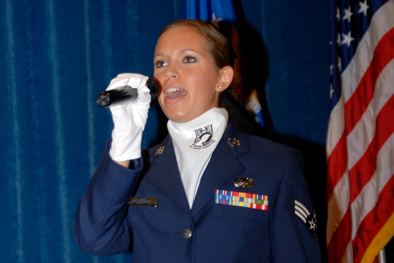 McGHEE TYSON AIR NATIONAL GUARD BASE, Tenn. -- Senior Airman Jennifer M. Kuklenski, an intelligence analyst with the 148th Fighter Wing in Duluth, Minn., sings the national anthem during the graduation ceremony of Airman Leadership School Class 09-6 at The I.G. Brown Air National Guard Training and Education Center here, Oct. 29, 2009.  Kuklenski was a member of A-Flight.  (U.S. Air Force photo by Master Sgt. Kurt Skoglund/Released)
