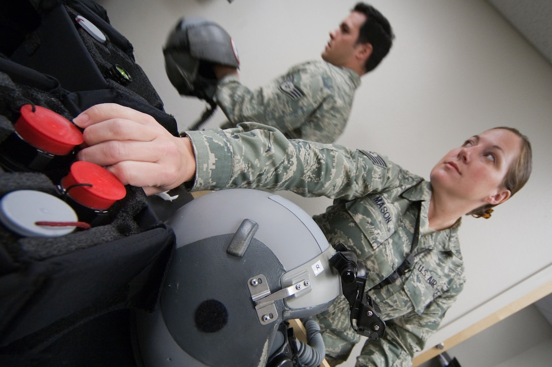 Air Force Tech. Sgt. Sheron Mason and Staff Sgt. Jessie McCarley, from the 121st Fighter Squadron's Aircrew Flight Equipment section, inspect night vision equipment for a night-flying exercise at Davis-Monthan Air Force Base, Tucson, AZ, November 21, 2009. The 121FS, D.C. Air National Guard, is receiving two weeks of training in preparation for an upcoming Aerospace Expeditionary Force deployment in 2010. (U.S. Air Force photo by Staff Sgt. Gareth Buckland/Released).