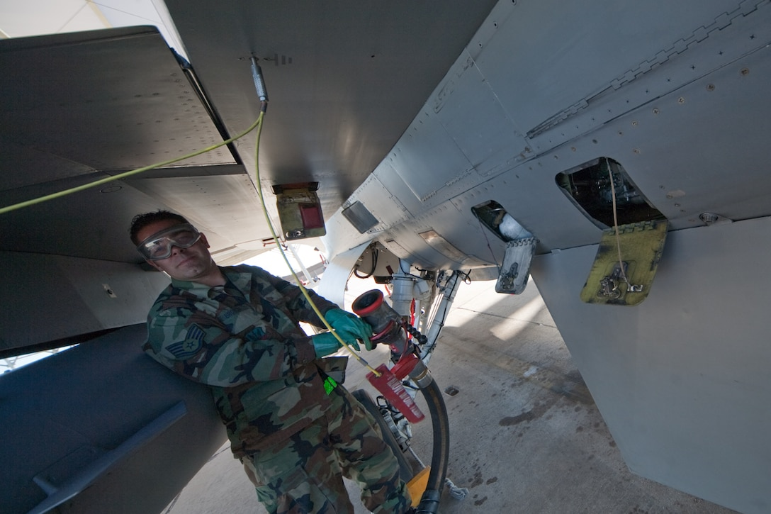 Air Force Staff Sgt. Brandon Brooks conducts F-16 refueling operations at Davis-Monthan Air Force Base, Tucson, AZ, November 21, 2009. The 121FS, D.C. Air National Guard, is receiving two weeks of training in preparation for an upcoming Aerospace Expeditionary Force deployment in 2010. (U.S. Air Force photo by Staff Sgt. Gareth Buckland/Released)