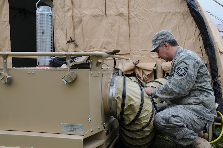 Master Sgt. Thomas Pilarz, 107th AW, Civil engineering Squadron prepares a self contained mobile heater for use. The heating system is complete with duct work, thermostat and a carbon monoxide detector.   The heaters are part of a new system that is being set up to provide temporary housing for Vigilant Guard military responders. (USAF Photo/SSgt. Peter Dean)