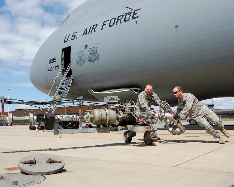 WRIGHT-PATTERSON AIR FORCE BASE, Ohio – Staff Sgts. Michael Nowicke and Shawn McKellop, 445th Logistics Readiness Squadron, prepare a pantograph for refueling C5 Galaxy aircraft at RAF Mildenhall , United Kingdom. Approximately 60 individuals from the 445 LRS performed their annual training at Mildenhall July 11-25. (U. S. Air Force photo/Maj. Jose A. Cardenas)