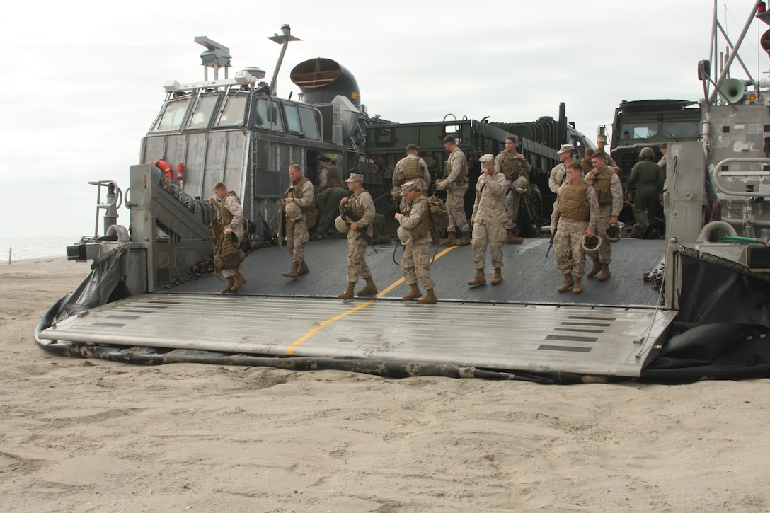 Marines from Combat Logistics Battalion 24, 24th Marine Expeditionary Unit, disembark a Landing Craft, Air Cushioned vessel from Assault Craft Unit – 4, to Onlsow Beach, N.C. to prepare for a Humanitarian Assistance exercise Oct. 31 as part of the 24th MEU's Composite Unit Training Exercise.  The HA exercise tested the 24th MEU's ability to operate as the landing force of the Nassau Amphibious Ready Group for its upcoming deployment.  (U.S. Marine Corps photo by Cpl. Alex C. Guerra)