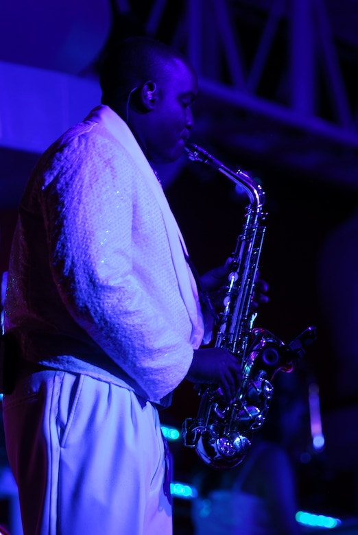 Blowing some cool blues on his alto saxophone during Tops in Blue is Senior Airman Tigh Lewis, 59th Medical Inpatient Squadron, Lackland Air Force Base, Texas. (U.S. Air Force photo by Staff Sgt. Anika Williams)