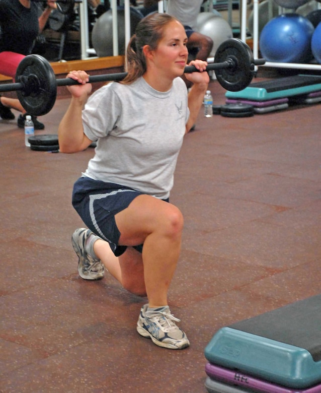 Second Lt. Melissa Croy does lunges during a workout Aug. 17, 2009, at the fitness center at Beale Air Force Base, Calif. Lieutenant Croy is one of the certified instructors for the new Body Pump program recently implemented to promote fitness at Beale.  (U.S. Air Force photo/Sandy Healy)