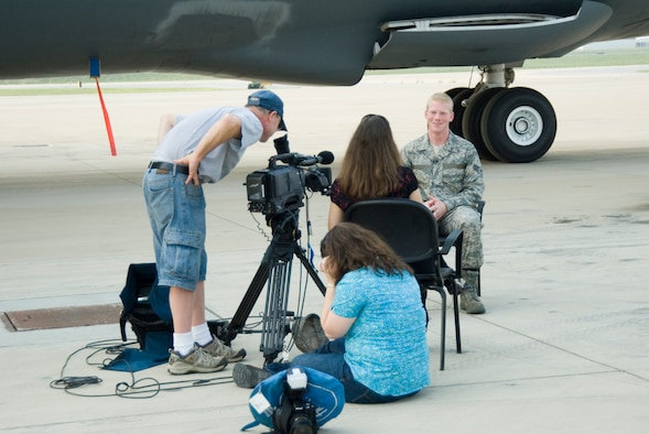 West Virginia University's Television Productions film crew conducts an interview with Senior Airman Nathan Sisler  at the 167th Airlift Wing, Martinsburg, West Virginia, on August 27, 2009. Sisler, a WVU senior and a West Virginia Airman of the Year recipient for 2009, was chosen to be featured in a new recruiting video for WVU because of his leadership qualities according to Kelly Heasley, special projects prouducer for WVU's Television Productions. (U.S. Air Force Photo by Emily Beightol-Deyerle)