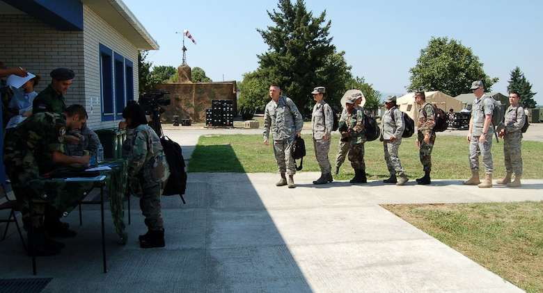 NIS, Serbia – Members of the Serbian Armed Forces Force Protection in-process Airmen Aug. 29 for participation in the military medical training exercise in Central and Europe, better known as MEDCEUR 2009, in Nis, Serbia. (U.S. Air Force photo/Senior Airman Kali L. Gradishar)