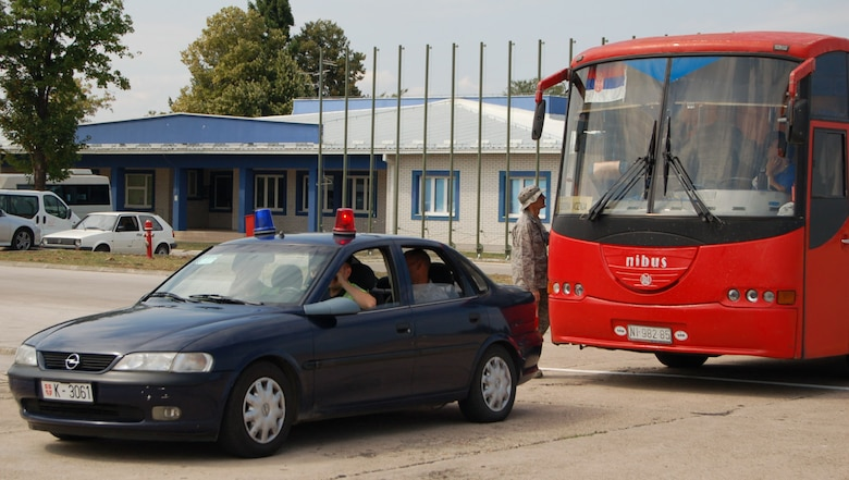 NIS, Serbia – A police escort waits for the departure of a bus carrying participants of MEDCEUR 2009, a military medical training exercise in Central and Eastern Europe, Aug. 31 after in-processing the group into the exercise, scheduled for Sept. 2-13. (U.S. Air Force photo/Senior Airman Kali L. Gradishar)