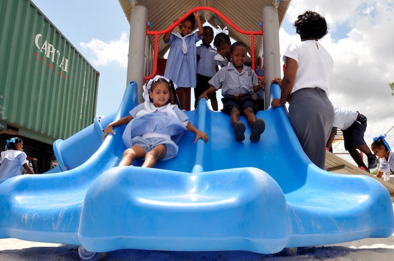 Guyanese children play on their brand new playground Sept. 1, 2009, at the Bel Air Primary, and Nursery Schools Georgetown, Guyana. U.S. Airmen built a playground for the primary school children, and one for the nursery school children, totaling over $ 37,000. (U.S. Air Force photo by Airman 1st Class Perry Aston) (Released)