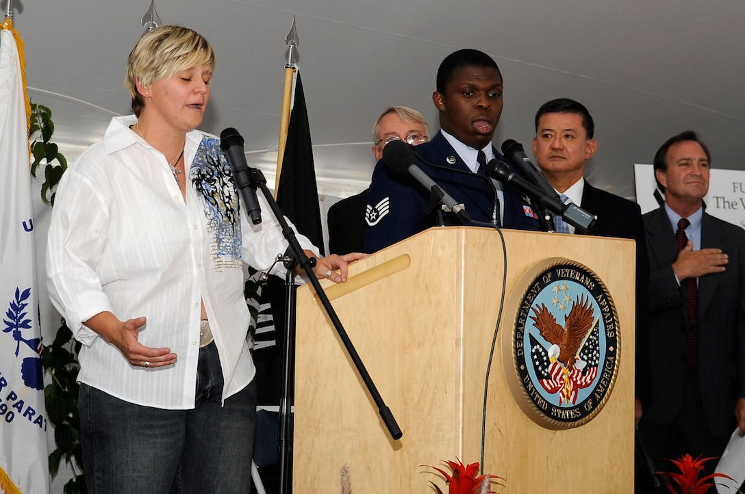 Singing the national anthem at the ground-breaking ceremony are Paige O'Hanlon, a veteran, and Staff Sgt. James Alston, 460th Operations Support Squadron. (U.S. Air Force photo by Senior Airman Erika Brooke)