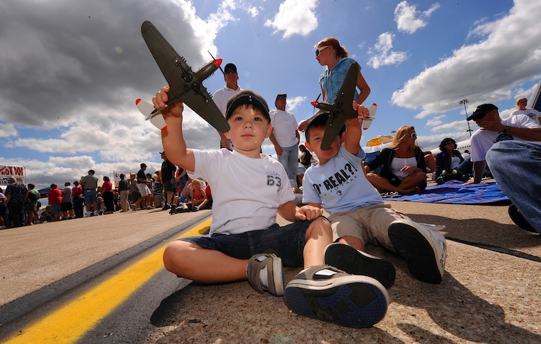 OFFUTT AIR FORCE BASE Neb. -- Three-year-old Brandon Kiger (left) and Two-year-old Jack Real (right), play with toy airplanes prior to the U.S. Navy's Blue Angels performance at the 2009 Defenders of Freedom Open House and Air Show Aug. 29. U.S. Air Force Photo by Josh Plueger