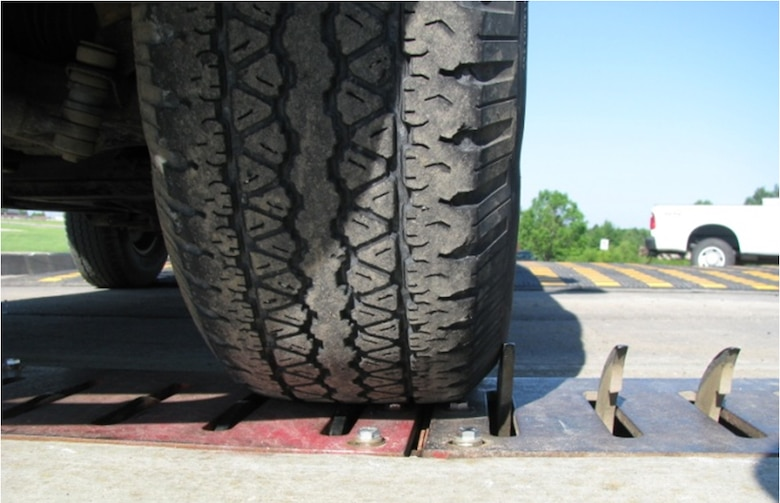 WHITEMAN AIR FORCE BASE, Mo. - Pictured here, steel anti-terrorism/force-protection spikes have recently been installed at each gate on the out-bound lanes to enhance base security. Base personnel are urged to be cautious when driving over the spikes to prevent tire damage. (Courtesy photo)