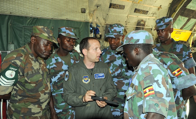 Staff Sgt. Josh Woolrich gives a tour of the U.S. Air Force C-130 to members of the Uganda Peoples Defense Force during a theater security cooperation event Aug. 26 at Entebbe Air Base, Uganda. (USAF photo by Maj. Paula Kurtz)
