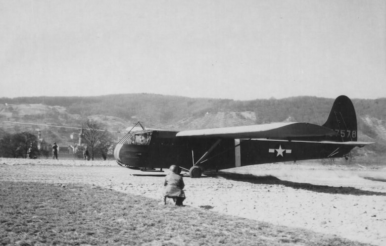 The CG-4A glider with Lt. Suella Bernard in the right-hand seat of the cockpit just as the glider is being snatched by a C-47. (U.S. Air Force photo)