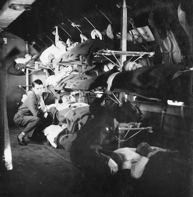 A medical technician and a flight nurse (lower right corner) tend to patients on a C-54 aircraft. The C-54 allowed larger numbers of patients to be air evacuated great distances. (Photo courtesy AFRL Research Division)