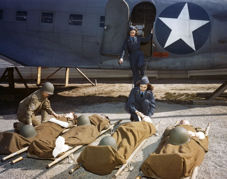 At the AAF School of Air Evacuation at Bowman Field, Ky., student flight nurses learned how to handle patients with the aid of a mock-up fuselage of a Douglas C-47 transport. (U.S. Air Force photo)