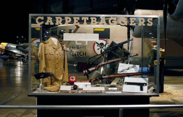 DAYTON, Ohio -- Operation CARPETBAGGER exhibit in the World War II Gallery at the National Museum of the U.S. Air Force. The CARPETBAGGERS dropped all types of supplies to the resistance forces in Europe: radios, batteries for radios, weapons, ammunition, first aid supplies, food, clothing, and many other daily necessities. However, they also delivered items used in the world of espionage agents. (U.S. Air Force photo)