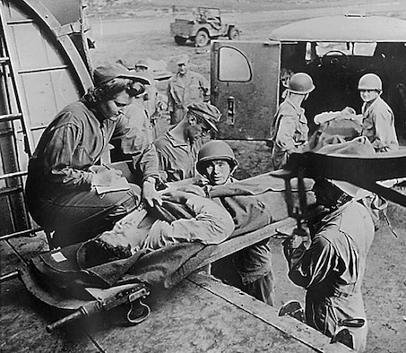 Flight nurse Lt. Mae Olson takes the name of a wounded American soldier being placed aboard a C-47 for air evacuation from Guadalcanal in 1943. (U.S. Air Force photo)