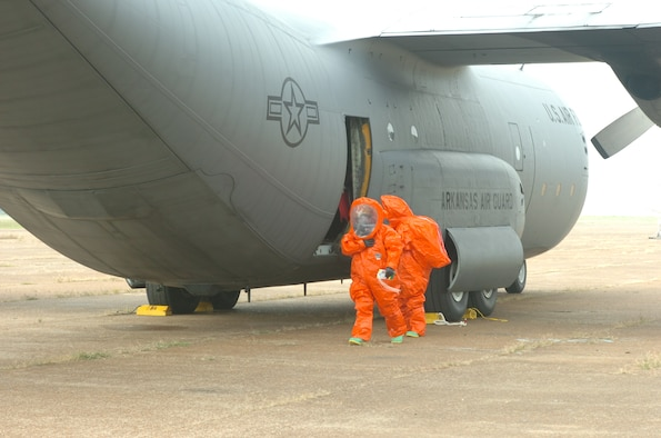 Members of the Walnut Ridge Fire Department's HAZMAT Response Team investigate a chemical spill and compartment fire aboard a C-130 aircraft during an exercise at the Walnut Ridge Airport on Tuesday, September 1, 2009.  The aircraft and crew were from the 189th Airlift Wing of the Arkansas Air National Guard based at Little Rock Air Force Base.  (Photo by Maj. Keith Moore, public affairs officer for the Arkansas Air National Guard.)