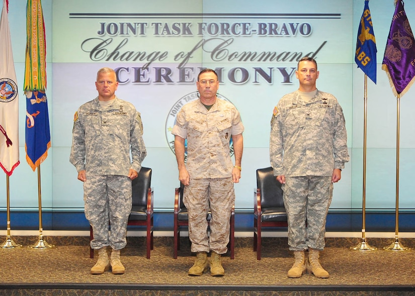 U.S. SOUTHERN COMMAND HEADQUARTERS, Miami — Army Col. Christopher Gehler (right) assumed command of Joint Task Force-Bravo from Army Col. Richard Juergens (left) during a ceremony at the U.S. Southern Command Headquarters in Miami September 3. Marine Corps Brig. Gen David Garza, chief of staff, U.S. Southern Command, (center) presided over the change of command. Joint Task Force-Bravo is one of three task forces under U.S. Southern Command. JTF-Bravo's primary mission is to provide command and control, administrative and logistical support for exercises, deployments and humanitarian and civic assistance projects conducted throughout Central America (Courtesy photo).