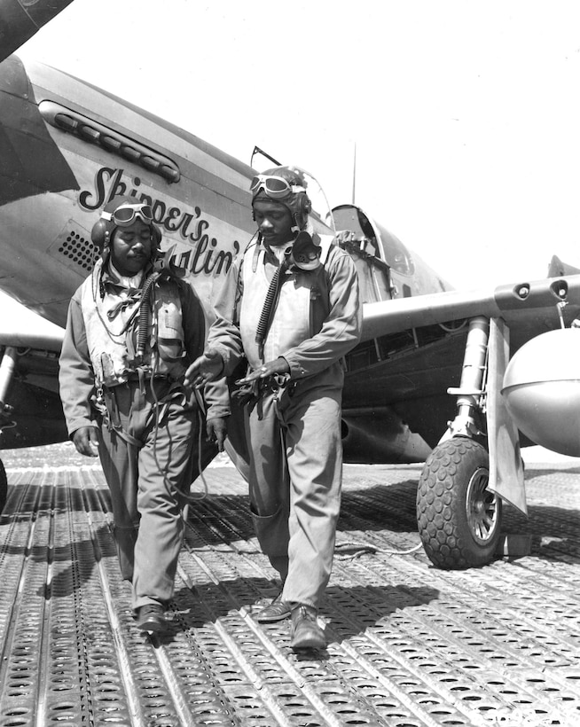 332nd Fighter Group pilots discuss combat flying. Their P-51 Mustangs, like the