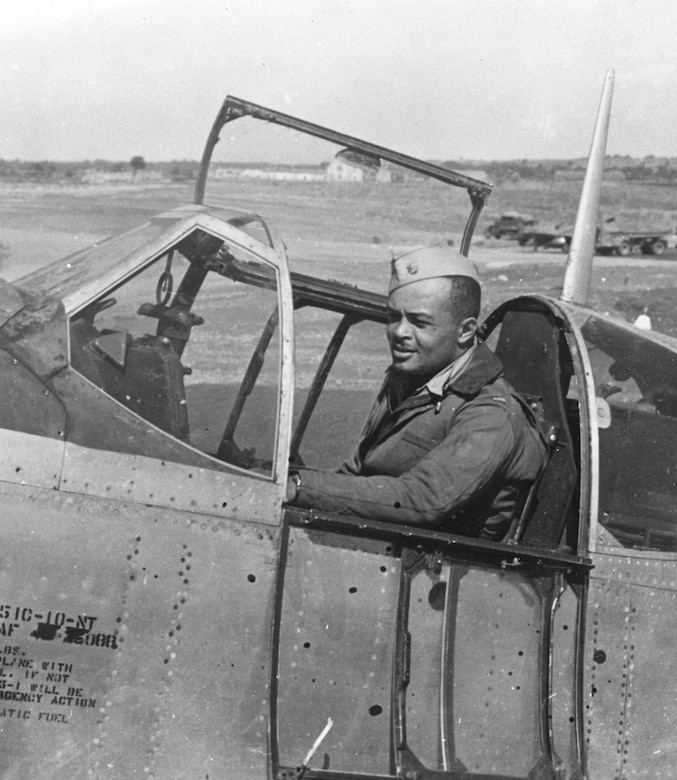 "Maj. George S. ""Spanky"" Roberts at the controls of a P-51 Mustang. Roberts was the first African American accepted for U.S. Army pilot training. He later commanded the 99th Fighter Squadron and the 332nd Fighter Group. (U.S. Air Force photo)"