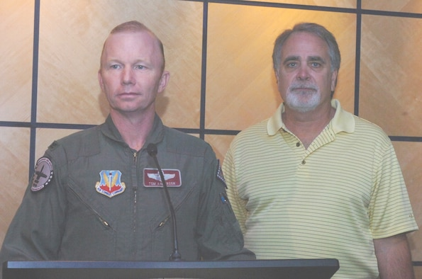 Col. Tom Anderson, commander of the 188th Fighter Wing of the Arkansas Air National Guard  (left) announces the dates for the Greater Fort Smith Airshow 2010 during a press conference held at the wing's headquarters on Wednesday, Sept. 9, 2009.  Anderson is accompanied at the microphone by Chuck Fawcett, chairman of the sponsorships committee of the 188th Fighter Wing/Fort Chaffee Community Council.  The two-day event is planned for June 26-27, 2010, at the Fort Smith Regional Airport.  (Photo by Maj. Keith Moore, Public Affairs Officer, Arkansas Air National Guard.)