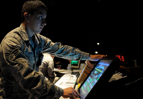 Senior Airman Nat Perez, 28th Operational Support Squadron air traffic control journeyman, monitors the airfield lighting panel in the control tower here, Sept. 2. Senior Airman Perez is of Hispanic descent and said he gains strength from his cultural heritage. September 15 through October 15 has been recognized as Hispanic Heritage Month since President Ronald Reagan's approval in 1988. (U.S. Air Force photo by Airman 1st Class Corey Hook)