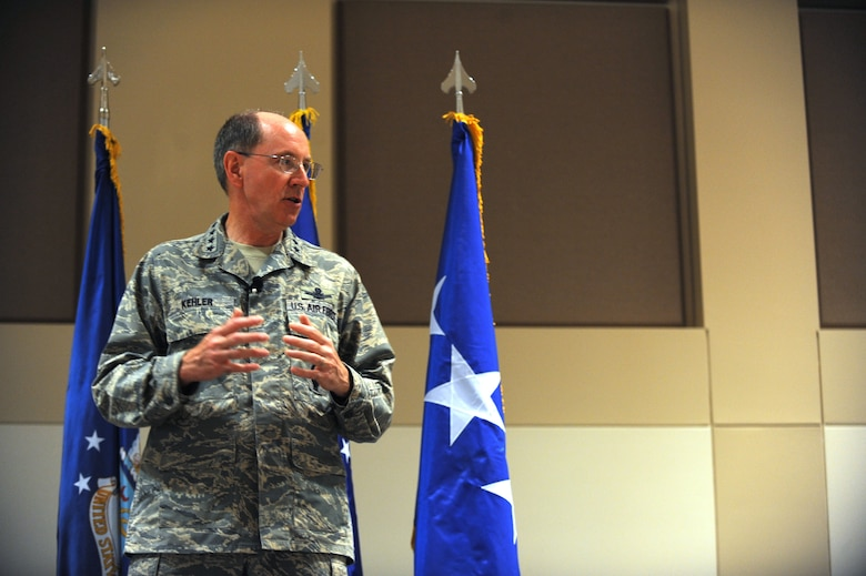 Gen. C. Robert Kehler, Air Force Space Command commander, addresses 460th Space Wing personnel during his commander's call Sept. 1. The general asked Airmen to stay safe and thanked them for a job well done. (U.S. Air Force photo by Airman 1st Class Paul Labbe)