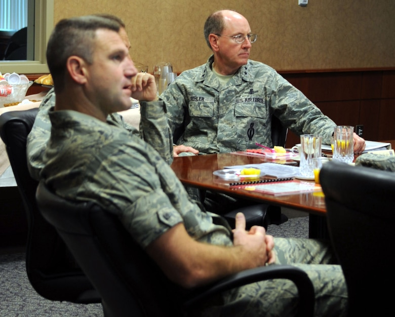 Gen. C. Robert Kehler, Air Force Space Command commander, listens to a briefing at Buckley Air Force Base, Colo. Sept. 1. During his visit, the general discussed Buckley's ongoing growth and the base's importance to the Air Force Space Command mission. (U.S. Air Force photo by Airman 1st Class Paul Labbe)