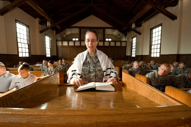 U.S. Air Force Rabbi, Chaplain, Captain Sarah D. Schechter (standing and wearing a tallit, prayer shawl) leads the evening le'il shabbat service on Friday, Sept. 4, 2009 at Lackland Air Force Base's Airmen Memorial Chapel. The more than 25 basic military trainees and other attendees participated in a religious education class, then Ma'ariv prayer service for the setting of the sun, followed by a meal provided by lay leaders supporting the service. Because of training schedules some ceremonies and events are earlier than traditionally held. By order of commanders, those who want to attend any or all religious services of their choosing are given full permission and opportunity to do so.  Chaplain, Captain Schechter is an Operation Iraqi Freedom veteran and considers her deployment there to be one of the highlights of her career. Schechter is the first woman rabbi in the U.S. Air Force. (U.S. Air Force photo/Lance Cheung)