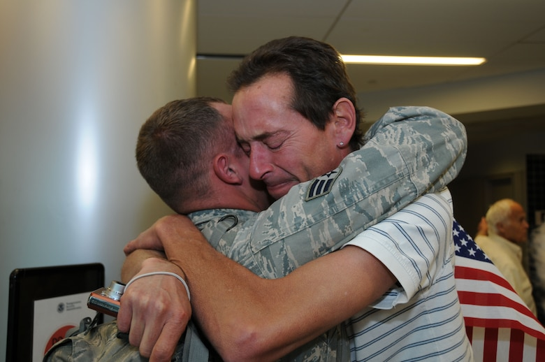 Senior Airman Justin Goerss embraces his older brother Dennis. ?I used to be his hero but now he?s mine,? said Dennis Goerss. (U.S. Air Force photo/Staff. Sgt. Peter Dean)