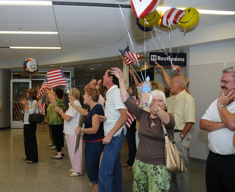 Family members, friends and loved ones gathered at the Buffalo International Airport on Sept. 3 awaiting the arrival of the final wave of 107th AW Security Force members to return home from their six month deployment. (U.S. Air Force photo/Staf. Sgt. Peter Dean)