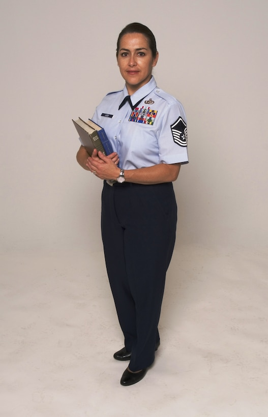 Master Sgt. Elisa Giese, 412th Test Wing Command Section superintendent, is an education mentor to six enlisted Airmen. Sergeant Giese is participating in Edwards' AFB Year of the Community College of the Air Force initiative that encourages its noncommissioned officers through senior NCOs to accomplish their CCAF degree requirements, such as English, math, speech, social science and humanities. (U.S. Air Force photo/Edward Cannon)