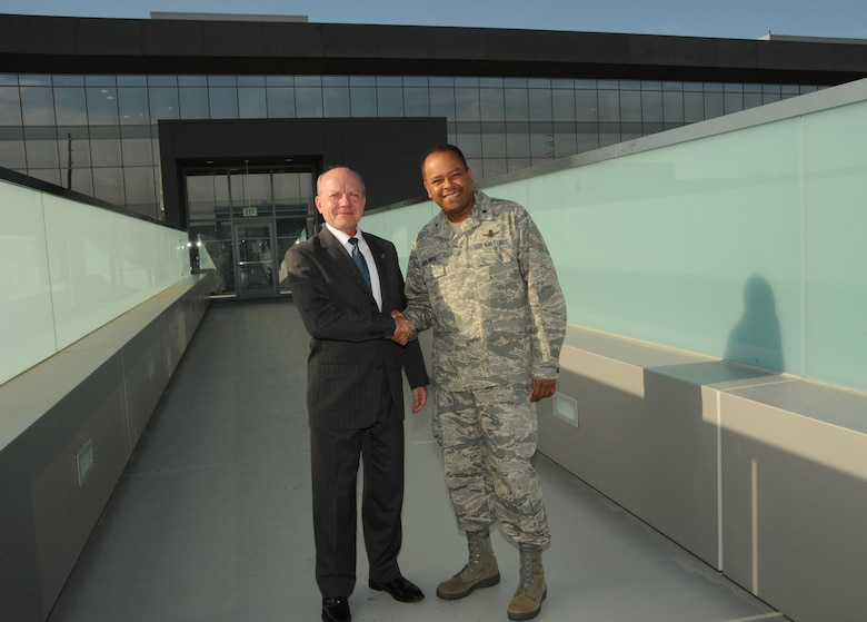 Dr. David Gorney, The Aerospace Corporation's Space Systems Group senior vice president, and Brig. Gen. Samuel Greaves, Space and Missile Systems Center vice commander, mark the completion of the new pedestrian bridge across El Segundo Blvd. linking Los Angeles Air Force Base and Aerospace's campus, Aug. 28.  A formal ceremony dedicating the bridge is scheduled for 11 a.m., Sept.  29 at base of the stairs on the Aerospace side. All base personnel are invited to attend. (Photo by Lou Hernandez)