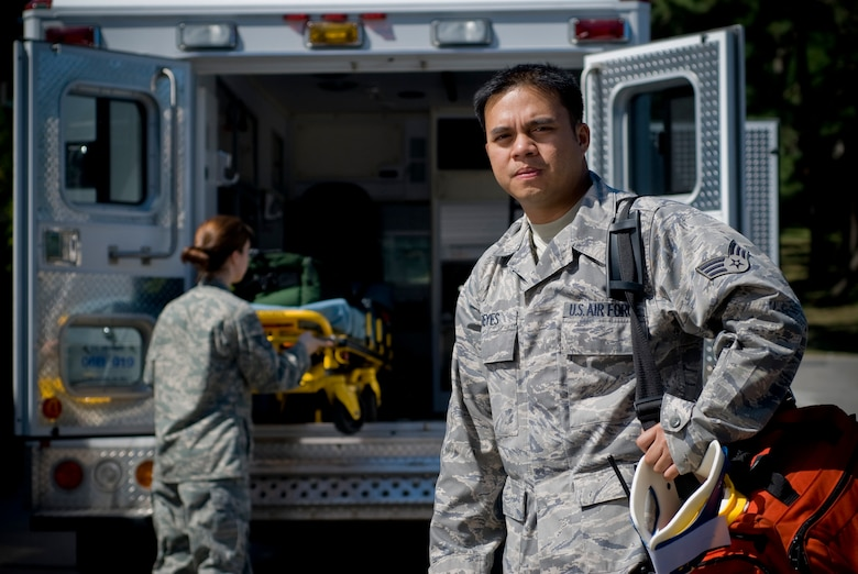 KUNSAN AIR BASE, Republic of Korea --Tech. Sgt. Samantha Mosher and Senior Airman John Reyes, 8th Medical Operations Squadron, stand in for an environmental portrait on Sept. 10. Sergeant Mosher and Airman Reyes are emergency medical technician qualified aerospace medical technicians assigned to ambulance services. Ambulance services primary duties are to respond to 911 calls, in-flight emergencies and sick call. (U.S. Air Force photo / Senior Airman Jonathan Steffen)