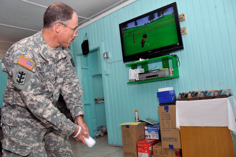 Lt. Col. David Silver commander of the 878th Engineer Battalion, Georgia Army National Guard, tests out the new Nintendo Wii that was donated to the Joshua's Place Orphanage Sept. 9, 2009. Soldiers from the Georgia Army National used donation money collected back home, to buy a 40 inch LCD TV, a Nintendo Wii with six video games, 20 MP3 players and a DVD/VCR player (U.S. Air Force photo by Airman 1st Class Perry Aston) (Released)