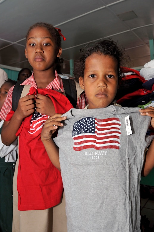 Guyanese girls from Joshua's Place Orphanage show off their new T-shirts Sept. 9, 2009. in Georgetown, Guyana. Soldiers from the Georgia Army National Guard brought 32 duffel bags of toys and clothes and over $3,800 in donated items to the orphanage. (U.S. Air Force photo by Airman 1st Class Perry Aston) (Released)